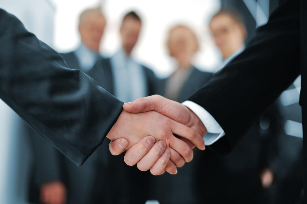 Handshake in front of business people